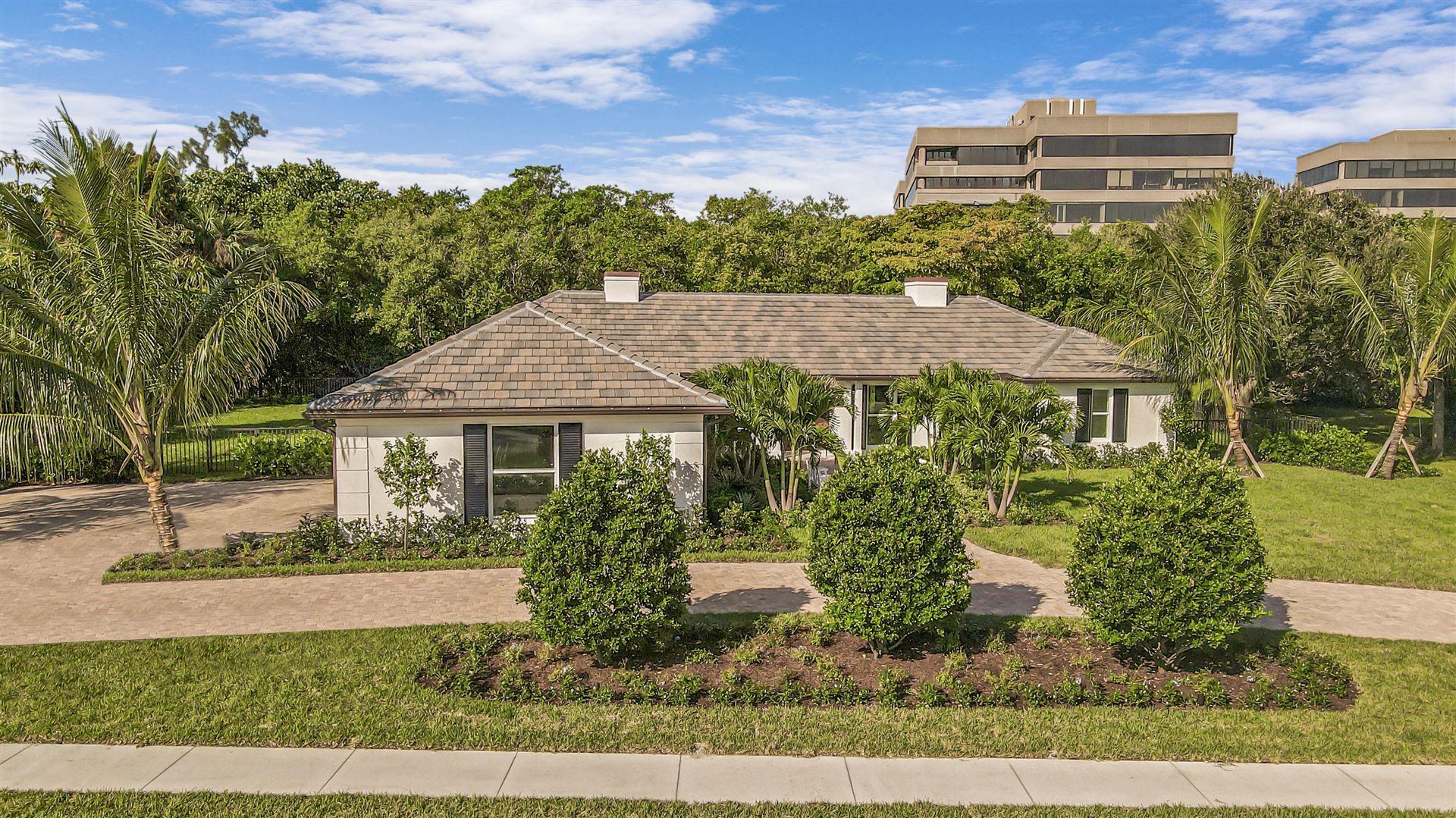 Photo of 11785 Lake Shore Place, North Palm Beach, FL 33408 (MLS # RX-10674320)