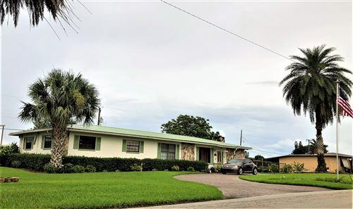 Photo of 317 NE 3rd Street, Belle Glade, FL 33430 (MLS # RX-10728322)
