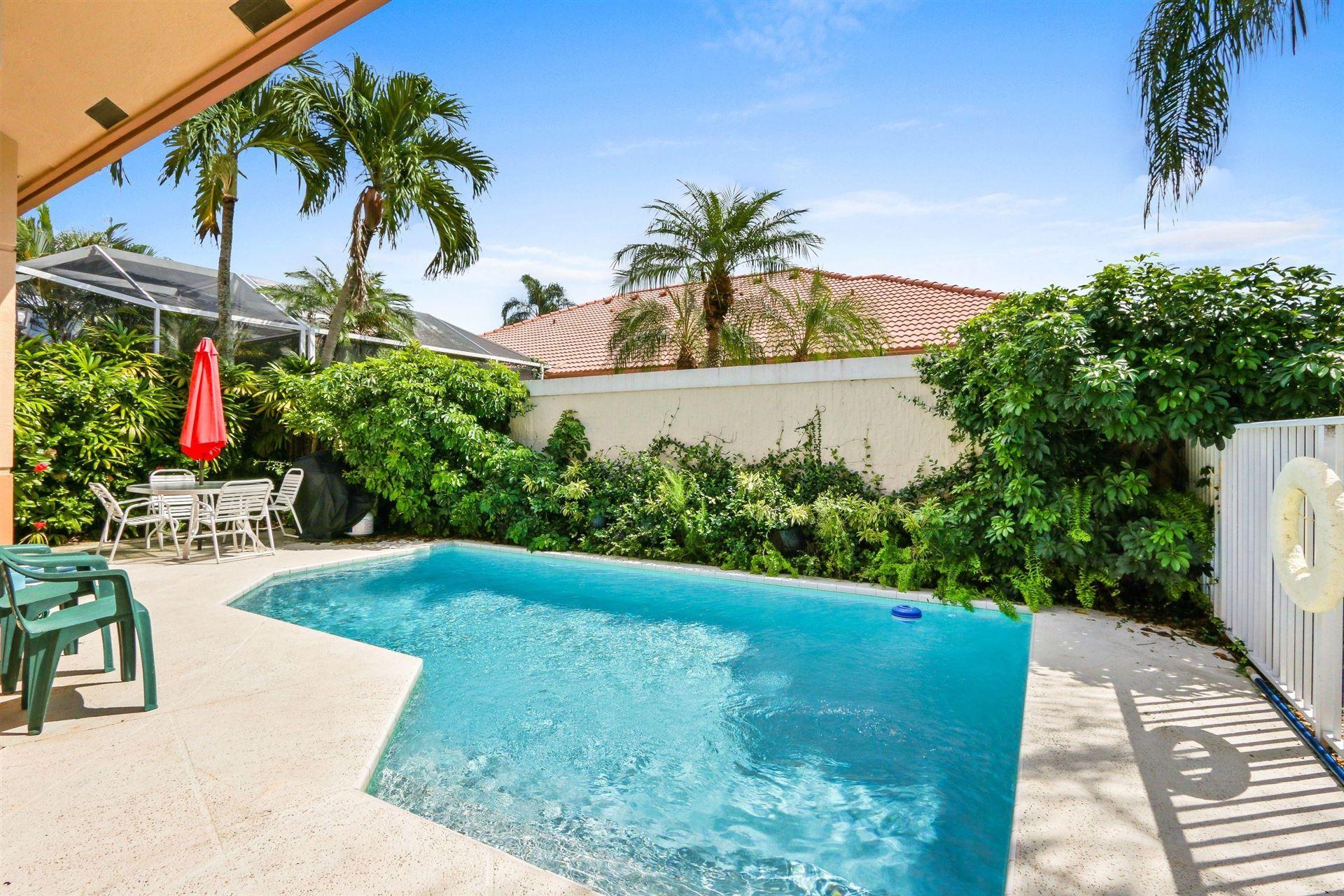 Photo of 32 Monterey Pointe Drive, Palm Beach Gardens, FL 33418 (MLS # RX-10603322)