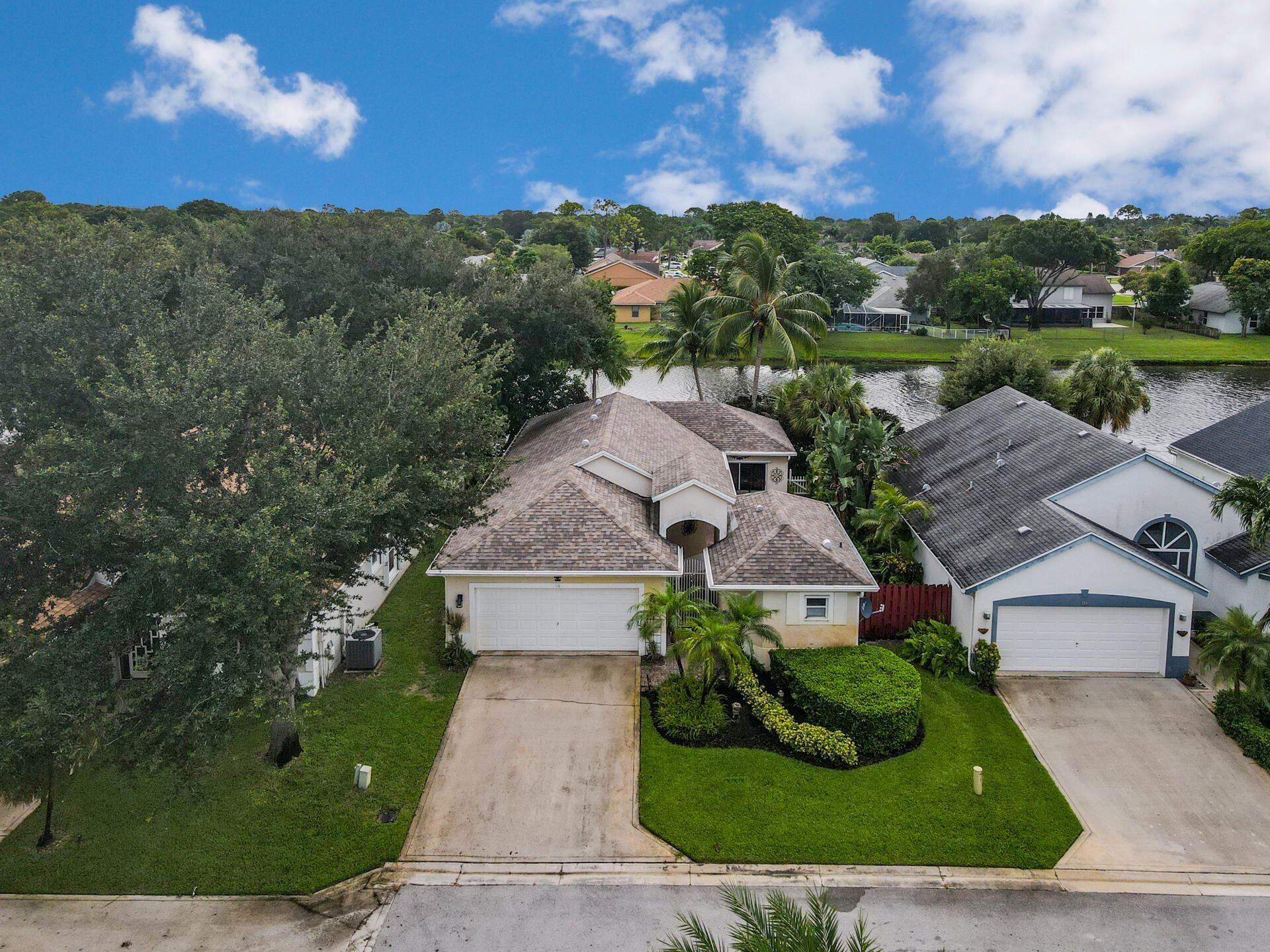 Photo of 116 Stirrup Lane, Royal Palm Beach, FL 33411 (MLS # RX-10736323)