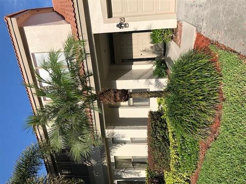 Photo of 5790 Coach House Circle #D, Boca Raton, FL 33486 (MLS # RX-10638326)