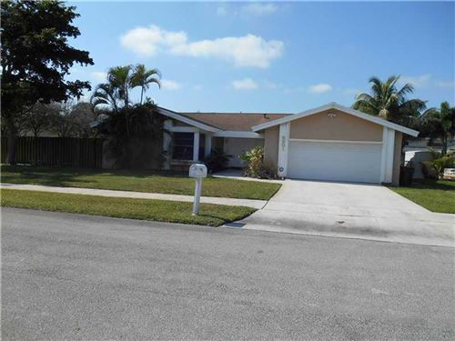 Photo of 6801 NW 26th Terrace, Fort Lauderdale, FL 33309 (MLS # RX-10644326)