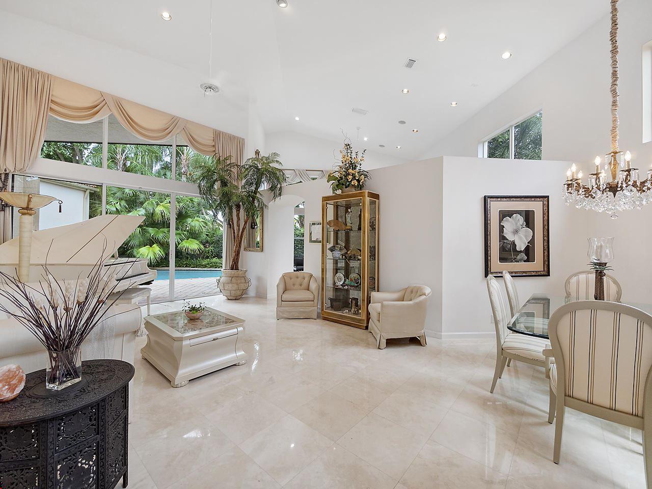 Photo of 128 Sunset Cove Lane, Palm Beach Gardens, FL 33418 (MLS # RX-10667328)
