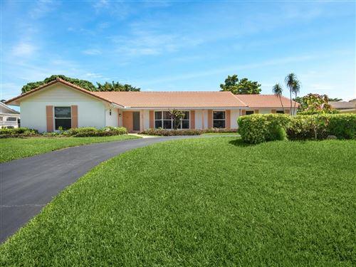 Photo of 473 N Country Club Drive, Atlantis, FL 33462 (MLS # RX-10732329)