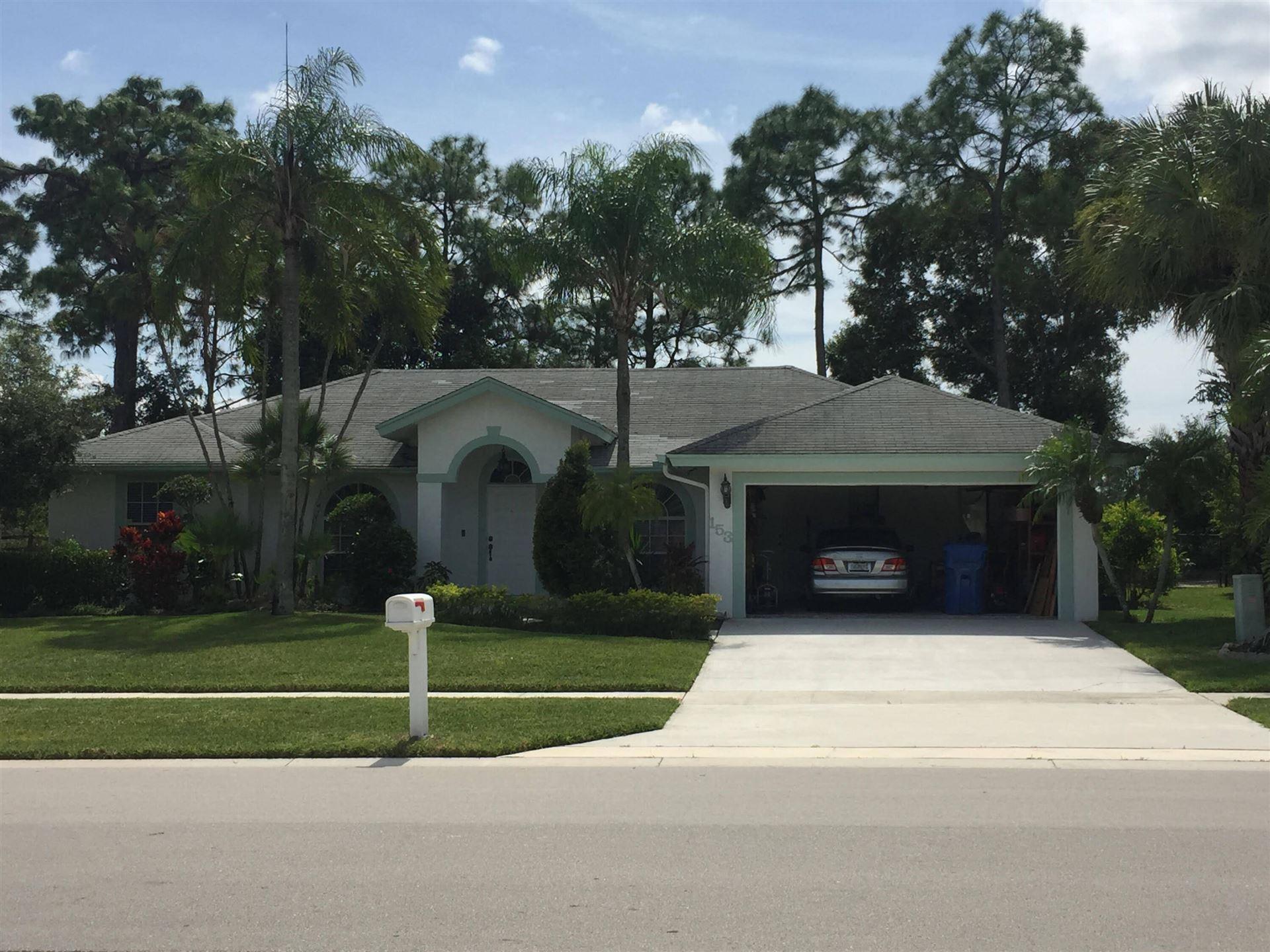 Photo of 153 Saratoga Boulevard W, Royal Palm Beach, FL 33411 (MLS # RX-10746329)