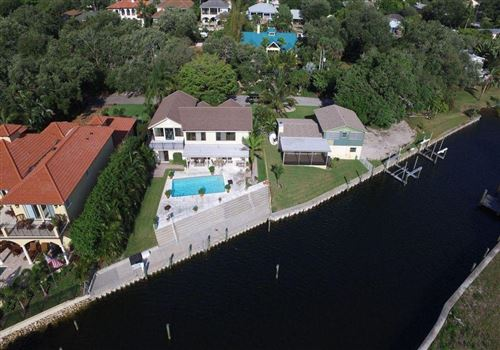 Photo of 12900 S Shore Drive, Palm Beach Gardens, FL 33410 (MLS # RX-10664331)