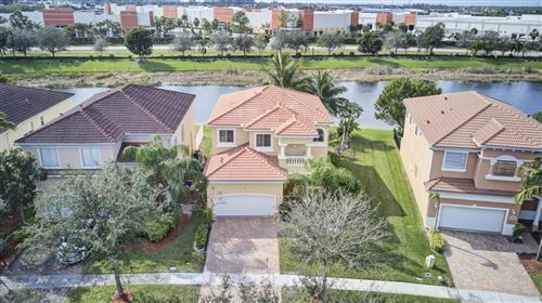 Photo of 643 Gazetta Way, West Palm Beach, FL 33413 (MLS # RX-10597332)