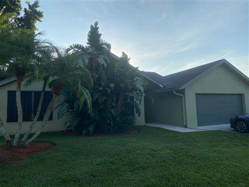 Photo of 8276 Blue Cypress Drive, Lake Worth, FL 33461 (MLS # RX-10657334)