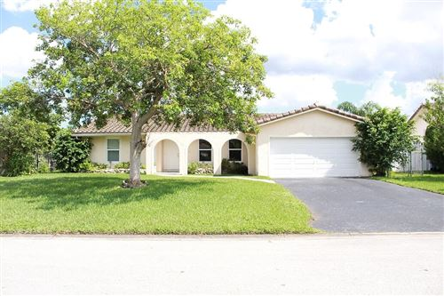 Photo of 1933 NW 83rd Drive, Coral Springs, FL 33071 (MLS # RX-10749336)