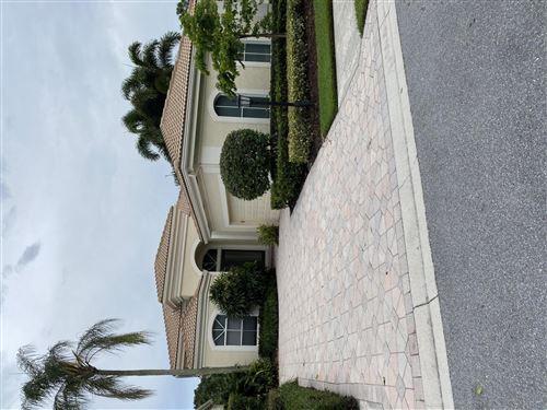 Photo of 112 Isle Dr, Palm Beach Gardens, FL 33418 (MLS # RX-10638338)