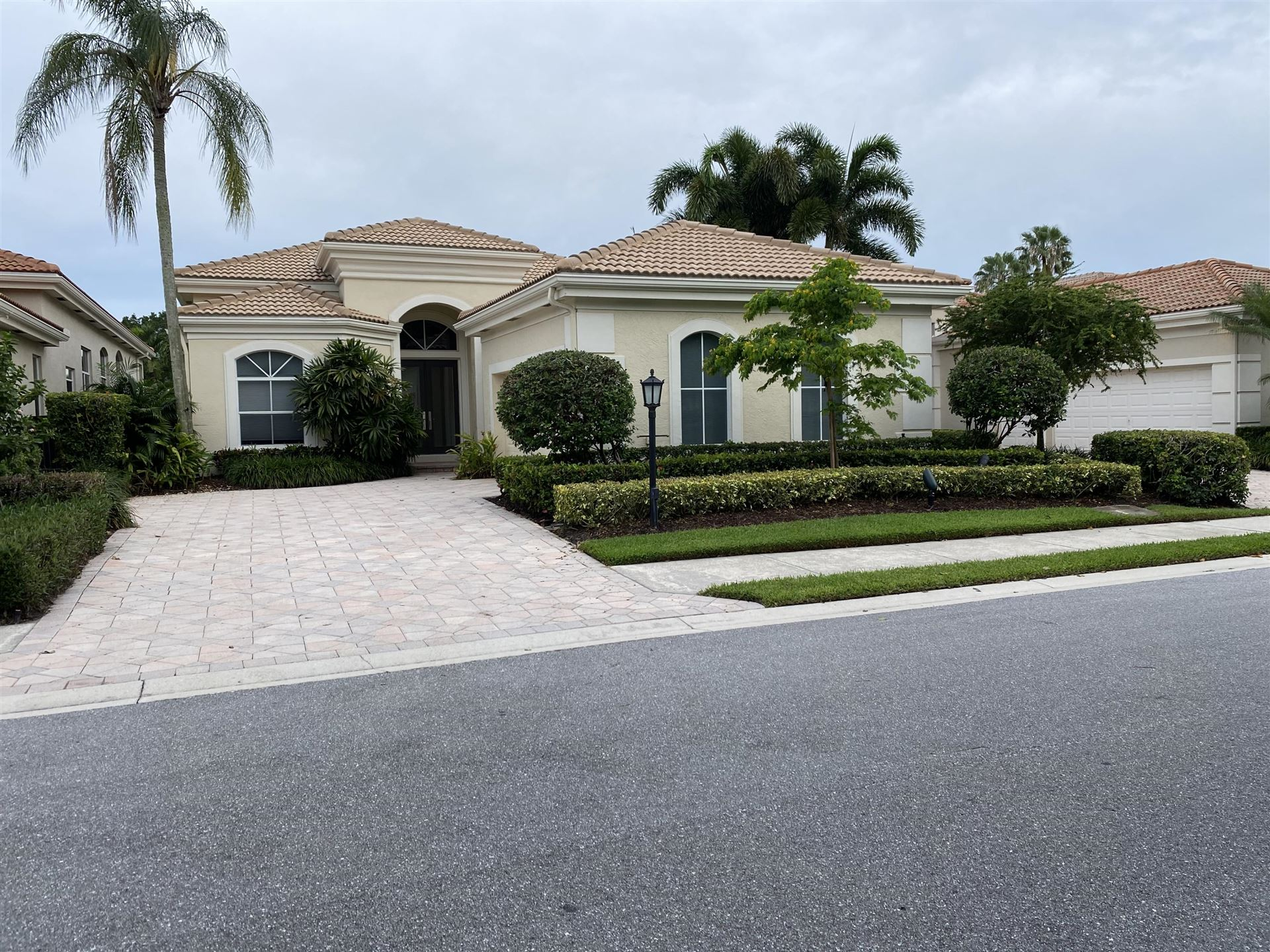 Photo of 112 Isle Dr, Palm Beach Gardens, FL 33418 (MLS # RX-10638338)