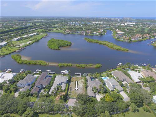Photo of 306 Eagle Drive, Jupiter, FL 33477 (MLS # RX-10432339)
