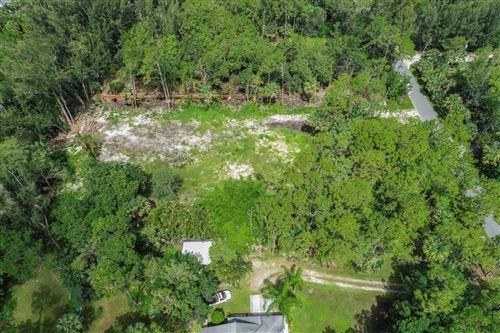 Photo of 9480 Whippoorwill Trail, Jupiter, FL 33478 (MLS # RX-10636339)