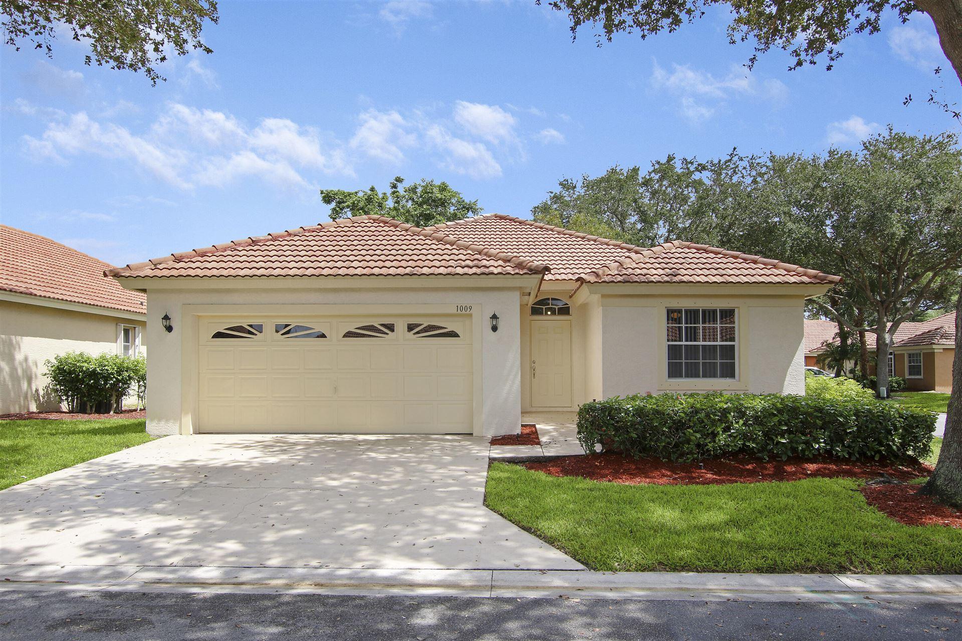 Photo of 1009 Aspri Way, Riviera Beach, FL 33418 (MLS # RX-10746339)
