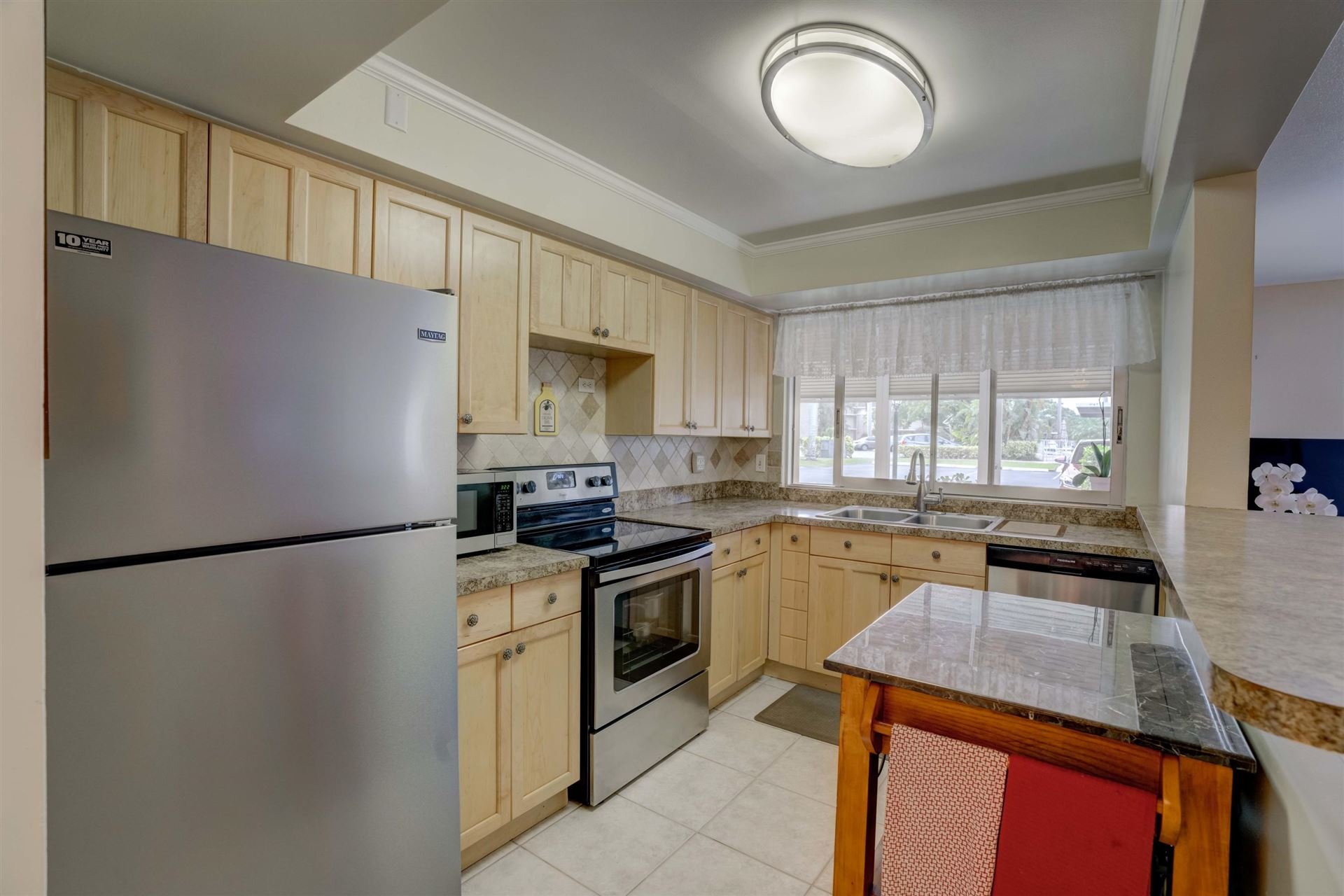 Photo of 5510 Tamberlane Circle #146, Palm Beach Gardens, FL 33418 (MLS # RX-10687340)
