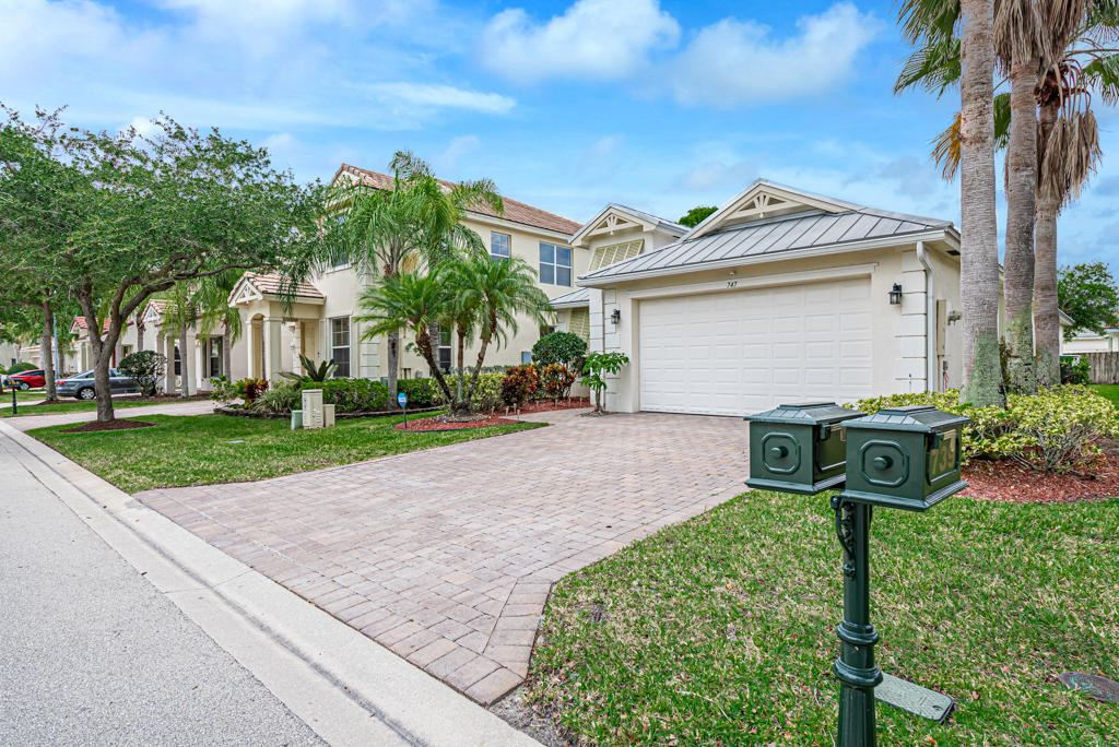 Photo of 747 Belle Grove Lane, Royal Palm Beach, FL 33411 (MLS # RX-10715342)