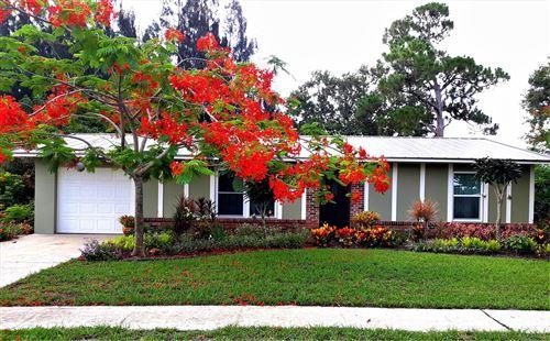 Photo of 119 NE Bracken Road, Port Saint Lucie, FL 34983 (MLS # RX-10657343)