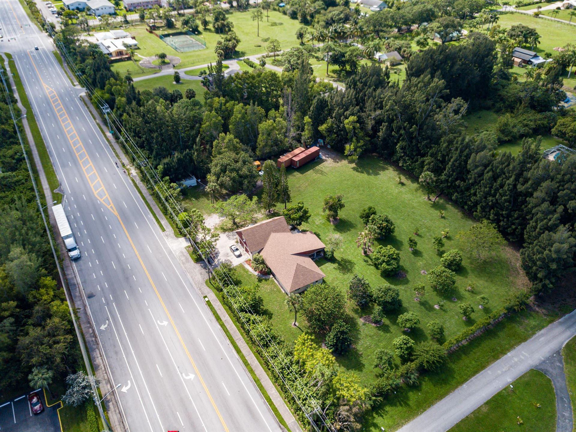 Photo of 3157 N Haverhill Road, West Palm Beach, FL 33417 (MLS # RX-10645344)