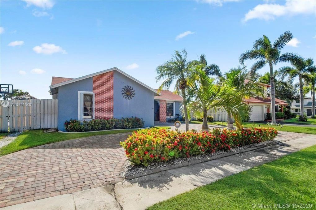 Photo of 11910 NW 38th Place, Sunrise, FL 33323 (MLS # RX-10713344)