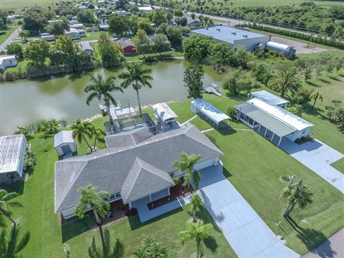 Photo of 1070 Chobee Loop, Okeechobee, FL 34974 (MLS # RX-10585345)