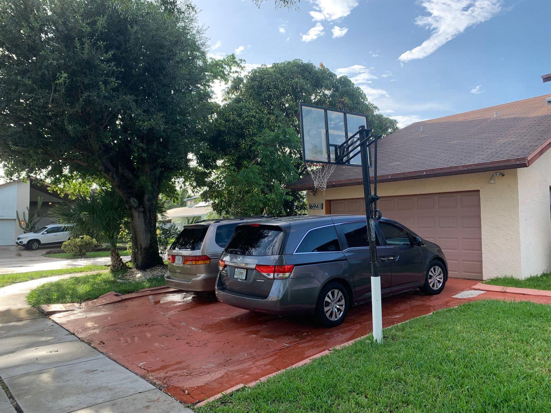 Photo of 6941 NW 45th Street, Lauderhill, FL 33319 (MLS # RX-10736345)