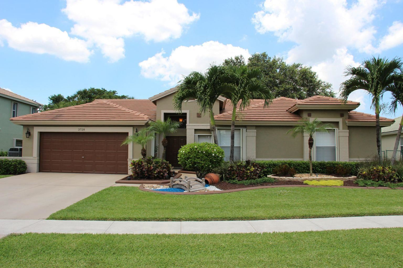 Photo of 3728 Cypress Lake Drive, Lake Worth, FL 33467 (MLS # RX-10715353)