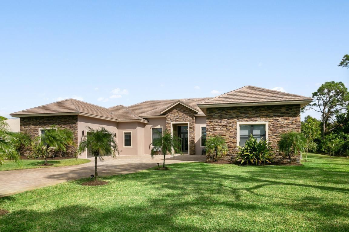 Photo of 10207 SW Stones Throw Terrace, Palm City, FL 34990 (MLS # RX-10624355)