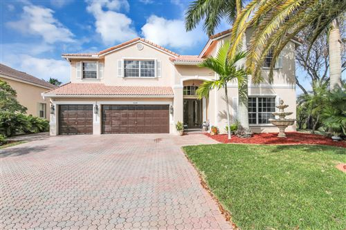 Photo of 5664 NW 106th Way, Coral Springs, FL 33076 (MLS # RX-10601356)