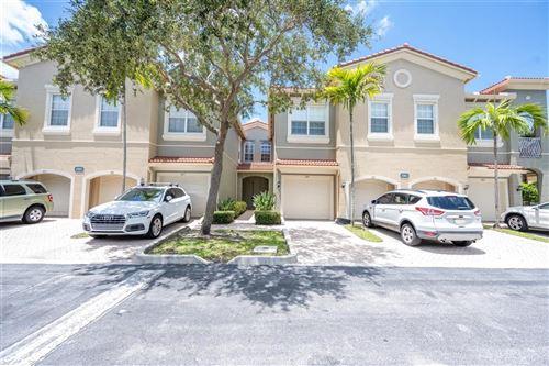 Photo of 4901 Bonsai Circle #105, Palm Beach Gardens, FL 33418 (MLS # RX-10645358)
