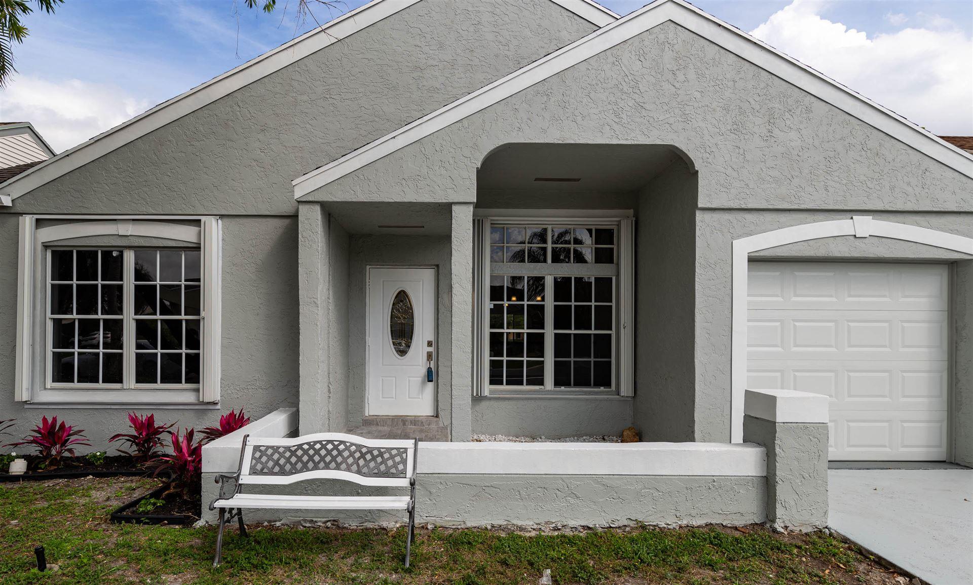 Photo of 23040 Floralwood Lane, Boca Raton, FL 33433 (MLS # RX-10696358)