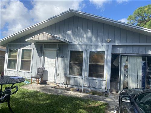 Photo of 6027 Roger Street, Jupiter, FL 33458 (MLS # RX-10666359)