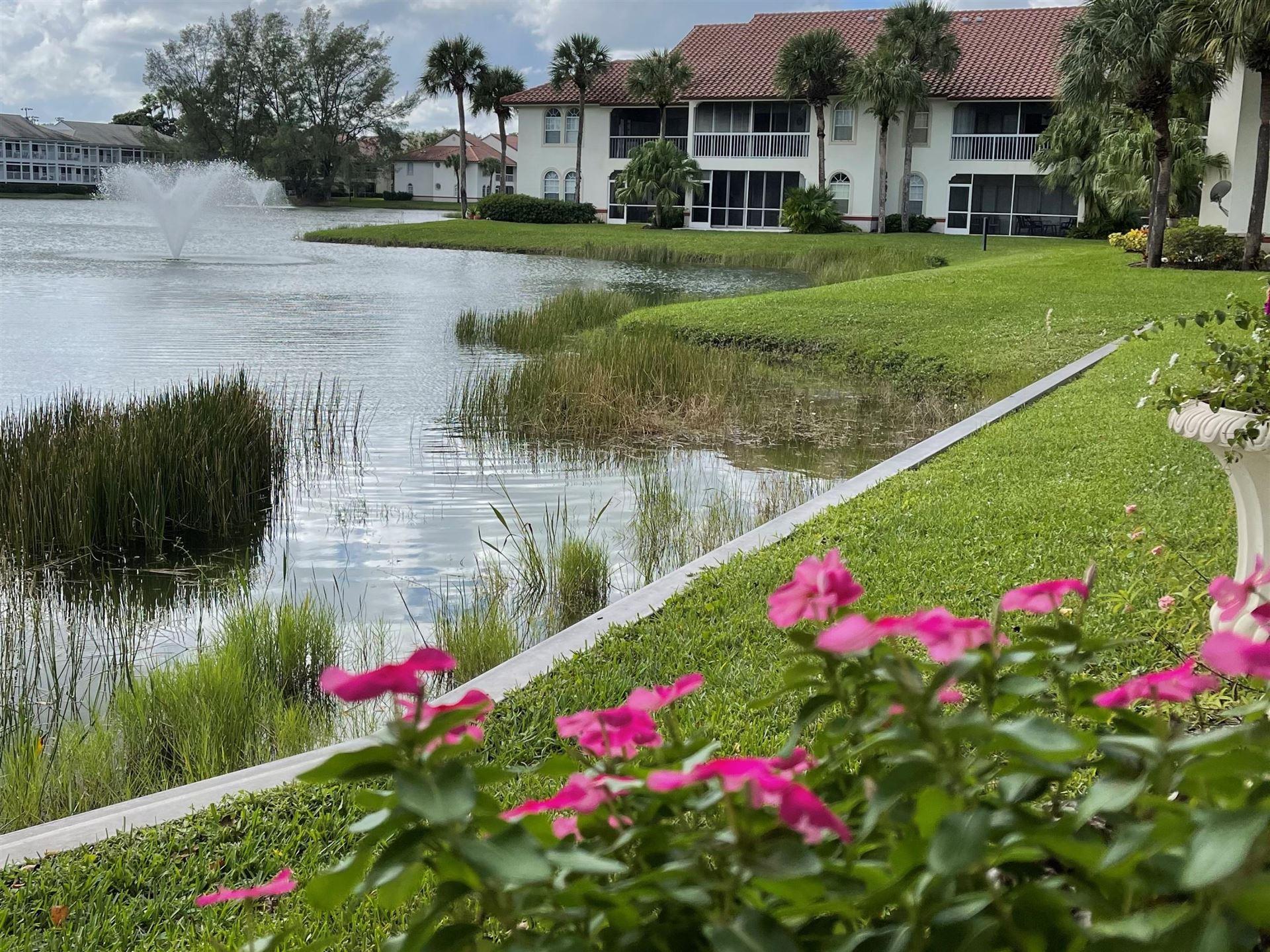 Photo of 104 Cypress Point Drive #104, Palm Beach Gardens, FL 33418 (MLS # RX-10672361)