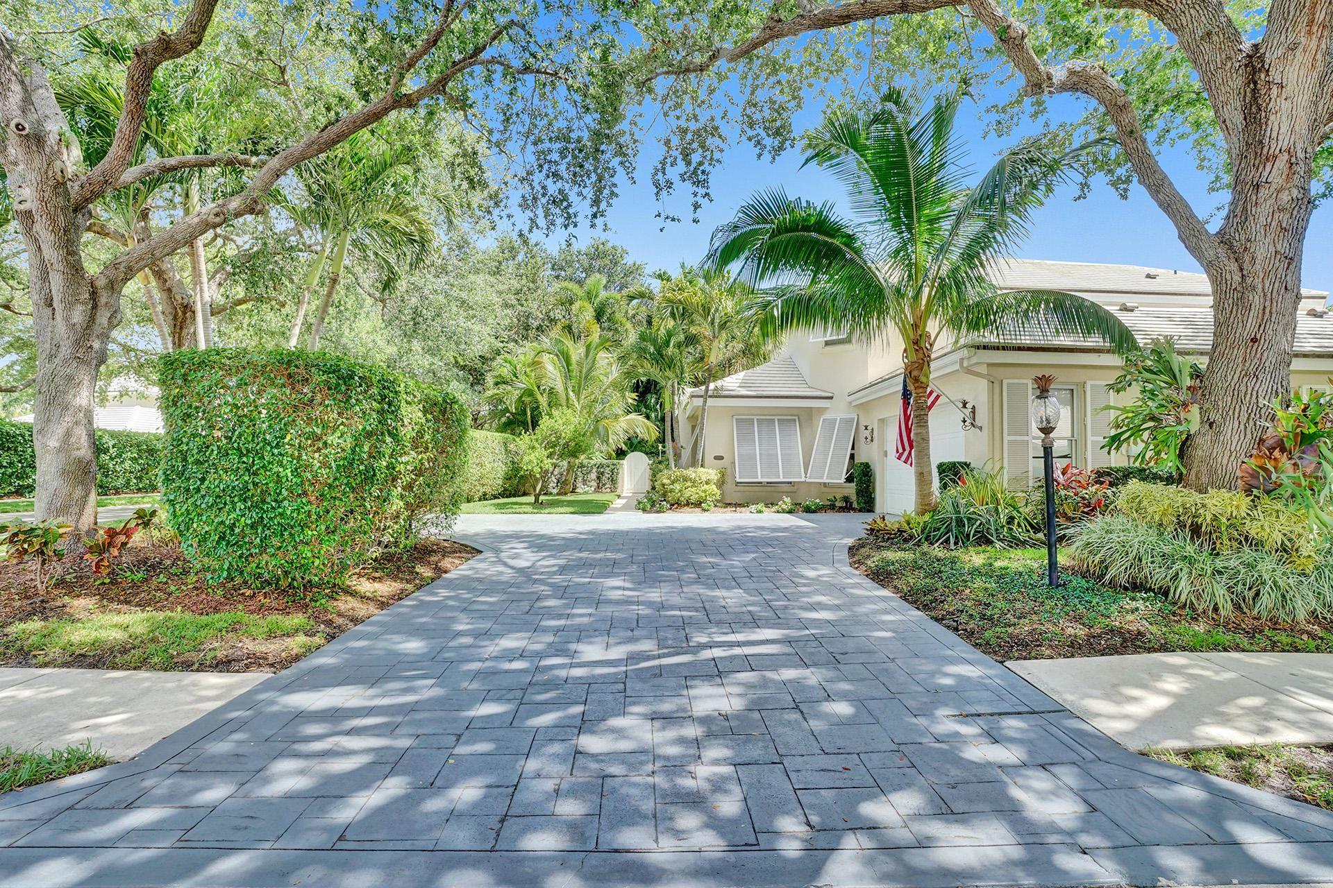 Photo of 2701 Cypress Island Drive, Palm Beach Gardens, FL 33410 (MLS # RX-10716364)