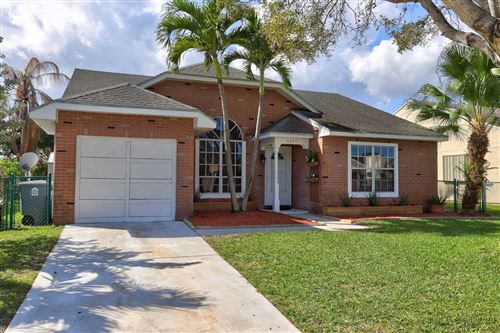 Photo of 5647 Pebble Brook Lane, Boynton Beach, FL 33472 (MLS # RX-10602365)