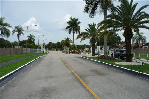 Photo of 5160 Las Verdes Circle #203, Delray Beach, FL 33484 (MLS # RX-10657367)