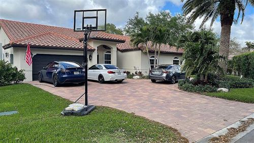 Photo of 10155 NW 48th Drive, Coral Springs, FL 33076 (MLS # RX-10696368)