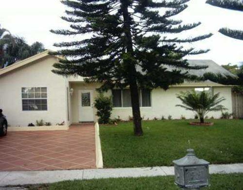 Photo of 604 SW 75th Way, North Lauderdale, FL 33068 (MLS # RX-10651369)