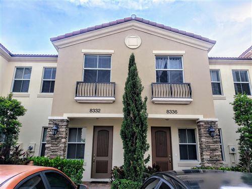 Photo of 8332 Cocoplum Sound Lane, West Palm Beach, FL 33411 (MLS # RX-10645370)