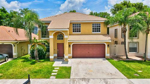 Photo of 10163 Serene Meadow Drive N, Boca Raton, FL 33428 (MLS # RX-10733370)