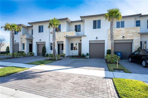 Photo of 1231 Pioneer Way, Royal Palm Beach, FL 33411 (MLS # RX-10714371)