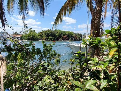 Photo of 2103 Cove Lane, North Palm Beach, FL 33408 (MLS # RX-10708374)