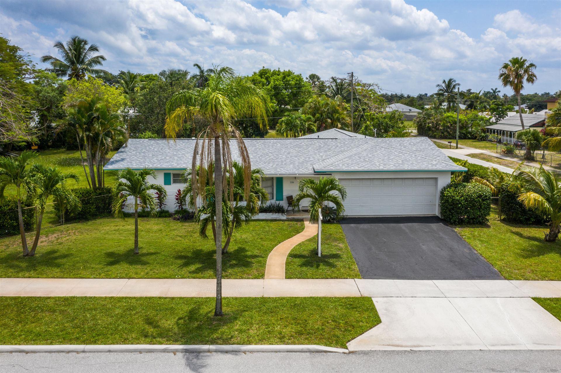 Photo of 330 W Ocean Avenue, Boynton Beach, FL 33435 (MLS # RX-10715375)