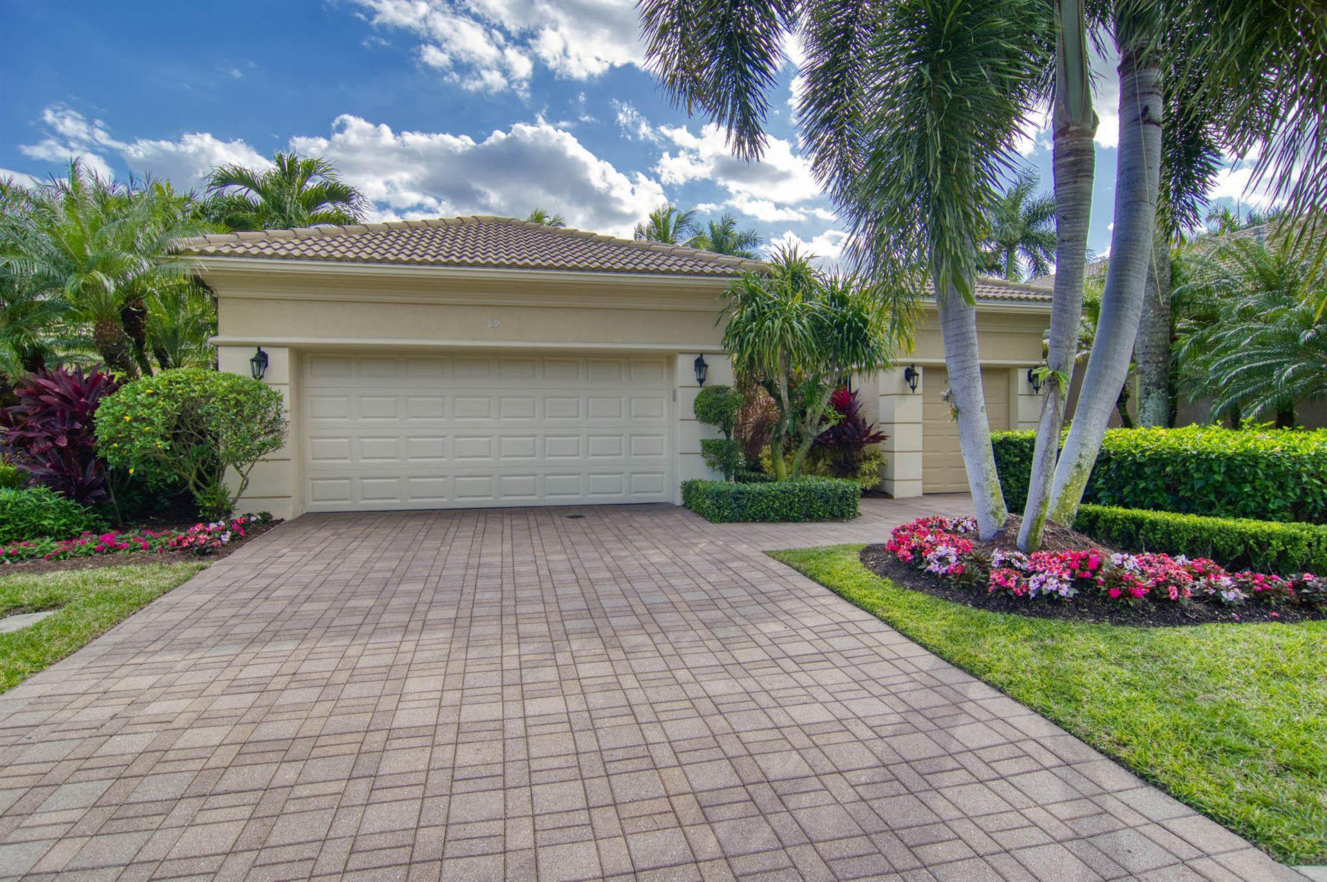 Photo of 89 Laguna Drive, Palm Beach Gardens, FL 33418 (MLS # RX-10686377)