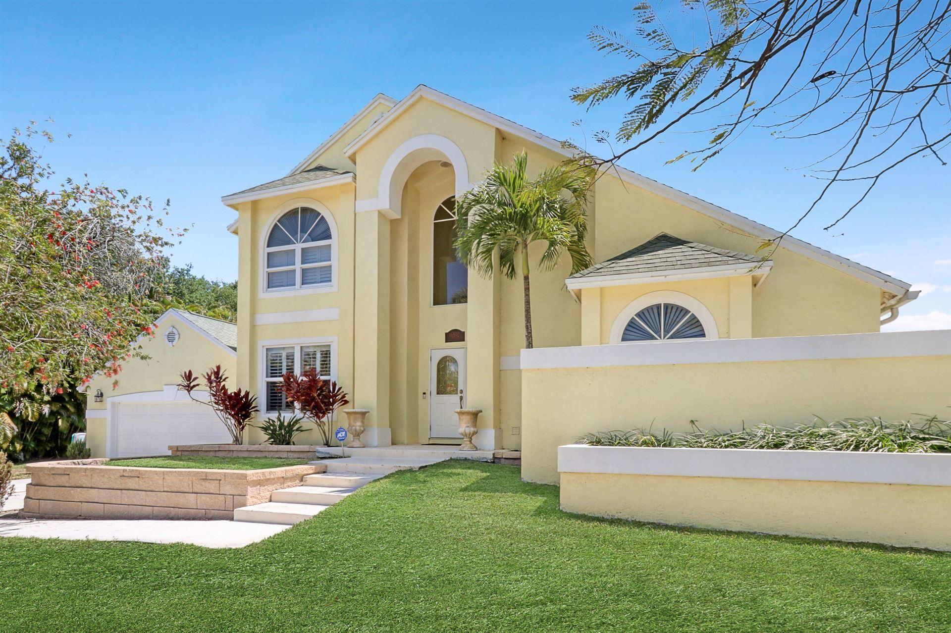 Photo of 16590 77th Trail N, Palm Beach Gardens, FL 33418 (MLS # RX-10708381)