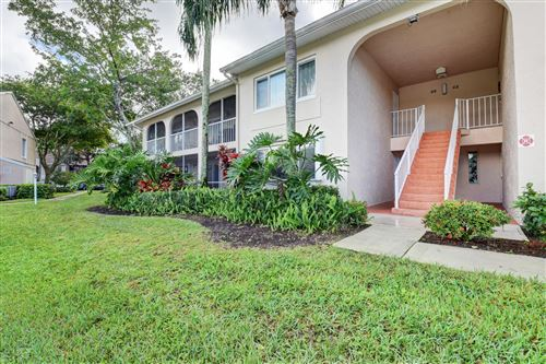 Photo of 13850 Oneida Drive #D1, Delray Beach, FL 33446 (MLS # RX-10595382)