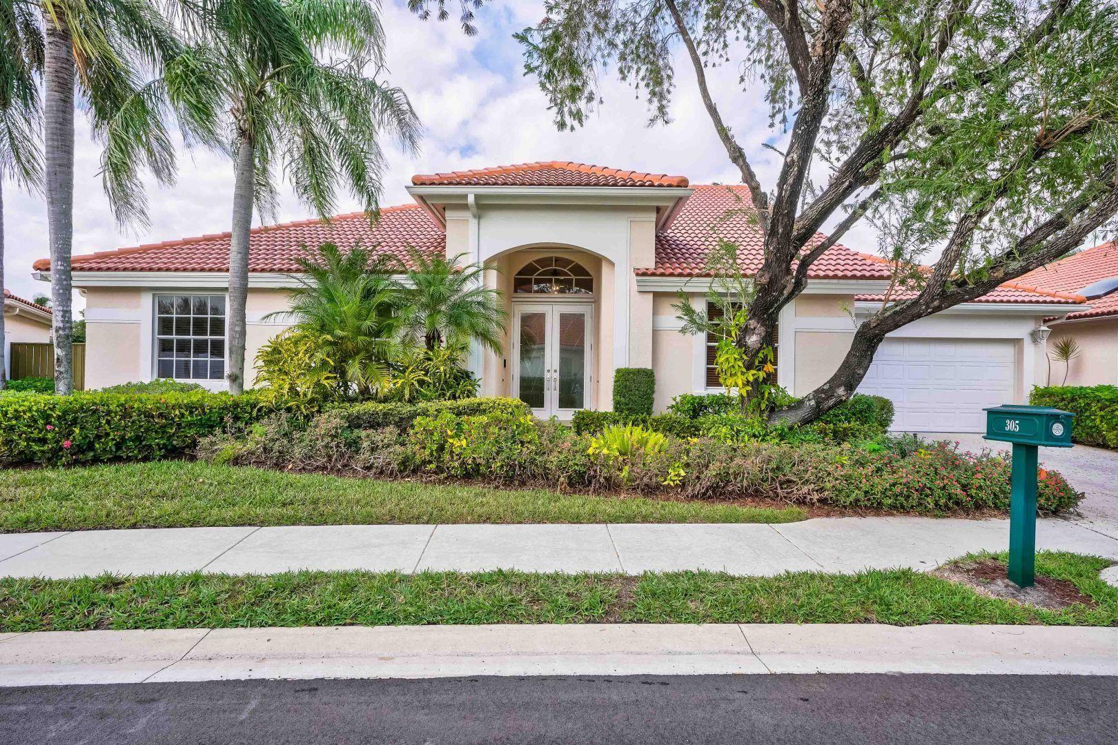 Photo of 305 Eagleton Estates Drive, Palm Beach Gardens, FL 33418 (MLS # RX-10694382)