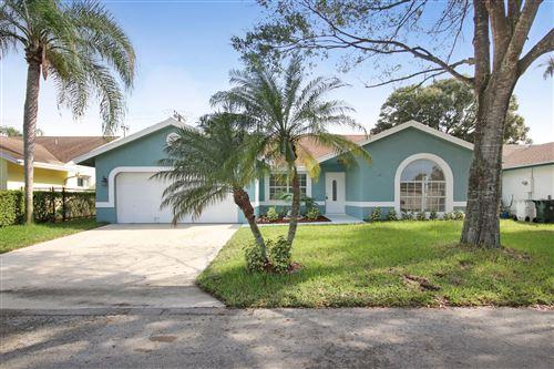Photo of 6630 NW 41 Terrace, Coconut Creek, FL 33073 (MLS # RX-10679383)