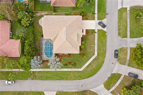 Photo of 12670 Whitby Street, Wellington, FL 33414 (MLS # RX-10694383)