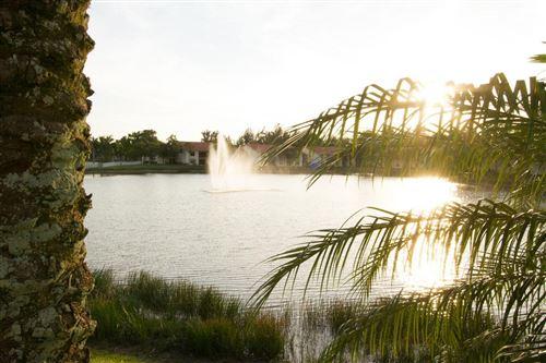 Photo of 1581 Windorah Way #B, West Palm Beach, FL 33411 (MLS # RX-10715384)