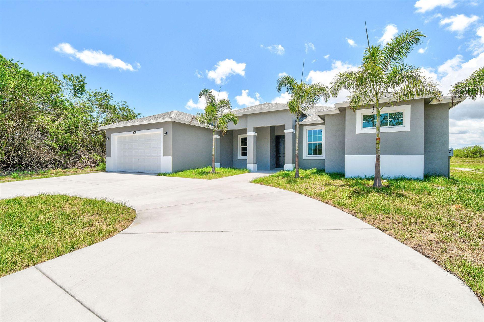 Photo of 508 SW Bradshaw Circle, Port Saint Lucie, FL 34953 (MLS # RX-10753384)